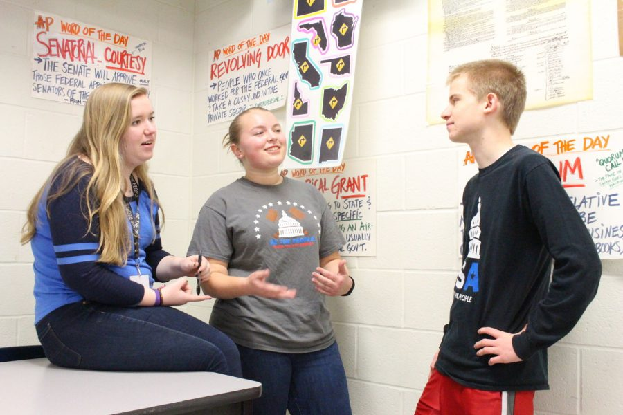 East senior Molly Sizemore discusses politics with senior Caitlyn Strunk and sophomore Weston Lindner.